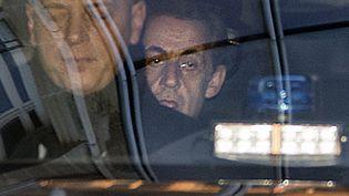 L'ancien président de la République, Nicolas Sarkozy, arrive au pôle financier du tribunal de grande instance de Paris, le 16 février 2016. (THOMAS SAMSON / AFP)