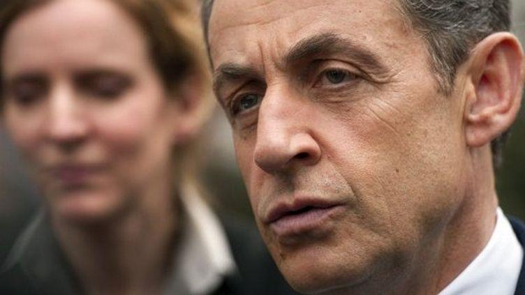 Nicolas Sarkozy au Kremlin-Bicêtre, dans le Val-de-Marne, le 14 avril 2012, peu avant son départ pour Perpignan. (LIONEL BONAVENTURE / AFP)