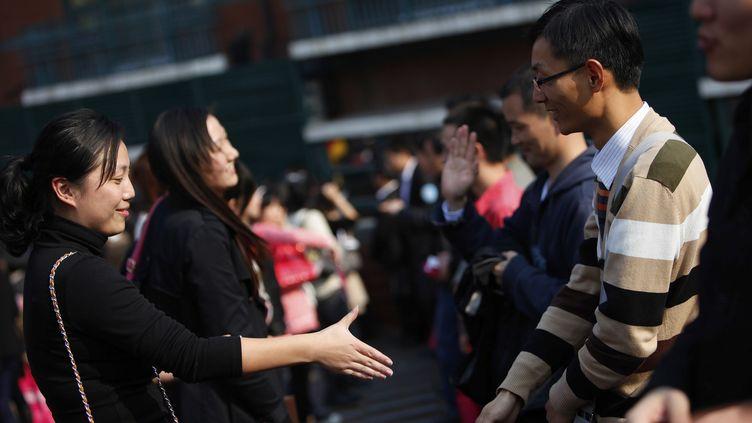 Près de 10 000 célibataires ont participé à un gigantesque speed-dating organisé les 12 et 13 novembre 2011 à Shanghai (Chine). (ALY SONG / REUTERS)