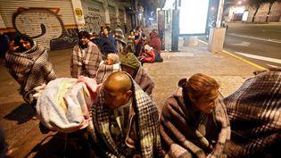 Des habitants de Mexico (Mexique) attendent dans la rue après un séisme de magnitude 8,2, jeudi 7 septembre 2017. (EDGARD GARRIDO / REUTERS)