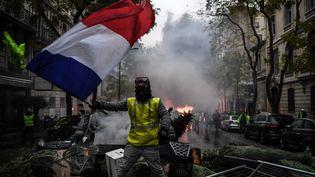 """Un manifestant lors de la mobilisation des """"gilets jaunes"""" à Paris, le 1er décembre 2018. (ALAIN JOCARD / AFP)"""