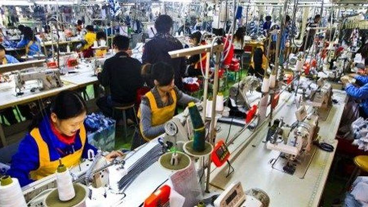 Usine textile en Chine, à Foshan, en décembre 2012. (Zhou chun / Imaginechina)