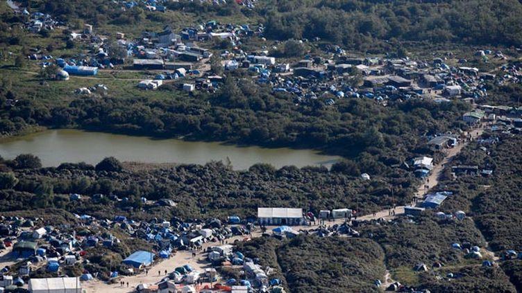 """(La """"Jungle"""" de Calais début octobre © REUTERS / Pascal Rossignol)"""