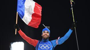 Martin Fourcade lors de l'épreuve de relais mixte de biathlon, àPyeongchang (Corée du Sud), le 20 février 2018. (FRANCK FIFE / AFP)