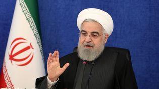 Le président iranien lors d'une conférence vidéo le 7 janvier, dans laquelle il a réagi aux violences réalisées au Capitole à Washington la veille. (AFP PHOTO / HO / IRANIAN PRESIDENCY)