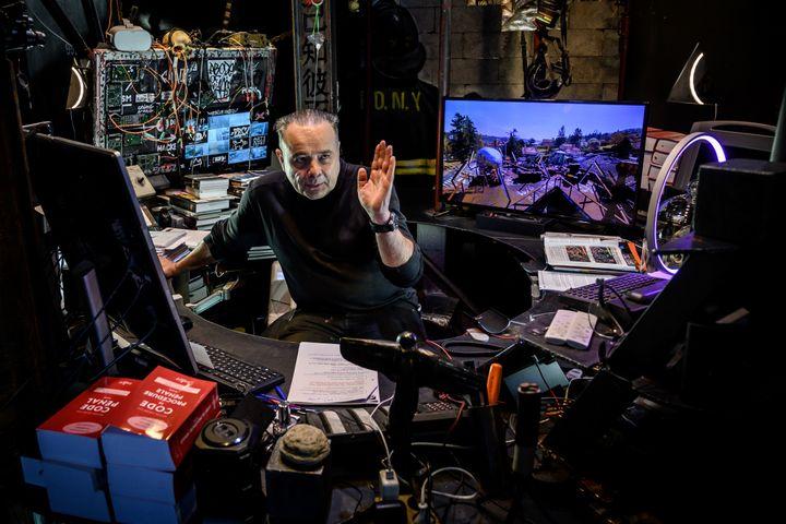 L'artiste et businessman Thierry Ehrmann, fondateur de la Demeure du Chaos et de Artprice, dans son bureau le 25 novembre 2019. (JEAN-PHILIPPE KSIAZEK / AFP)
