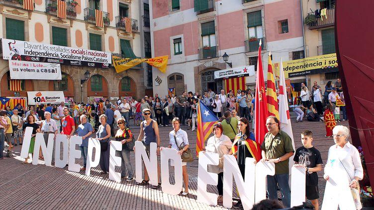 Des manifestants expriment leur soutien à une indépendance de la Catalogne, le 11 septembre 2010 à Barcelone (Espagne). (XAVIER BERTRAL / MAXPPP)