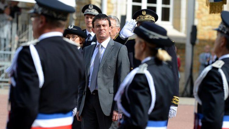Le ministre de l'Intérieur, Manuel Valls, à l'Ecole nationale supérieure de la police à Saint-Cyr-au-Mont-d'Or (Rhône), le 25 juin 2012. (PHILIPPE DESMAZES / AFP)