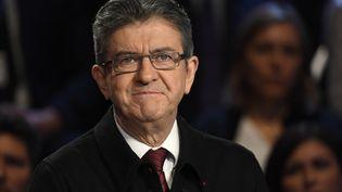"""Jean-Luc Mélenchon, lors du """"Grand Débat"""" de BFMTV et CNews, le mardi 4 avril. (LIONEL BONAVENTURE / AFP)"""