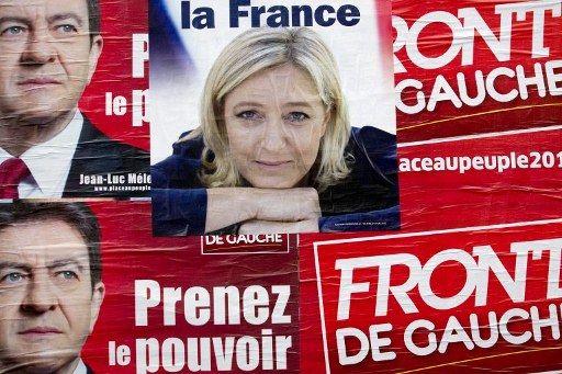 Les affiches de Marine Le Pen et Jean-Luc Mélenchon en avril à Paris (JOEL SAGET / AFP)