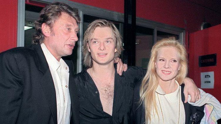 Johnny Hallyday en 2005 avec David et Sylvie Vartan  (BERTRAND GUAY / AFP)