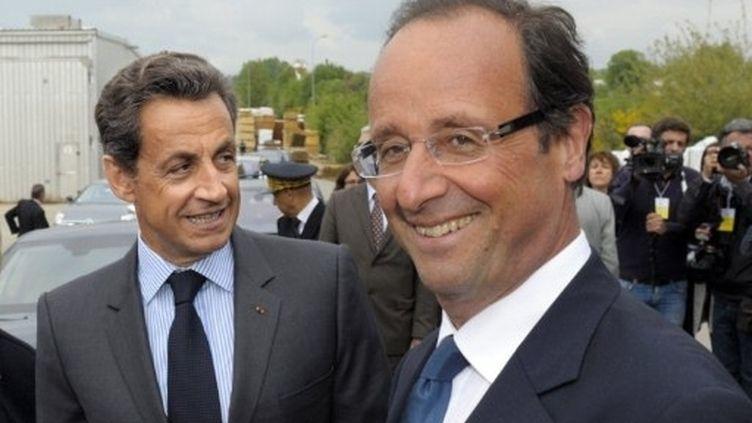 Nicolas Sarkozy et François Hollande à Egletons (Corrèze) le 28 avril 2011. (AFP - PHILIPPE WOJAZER)