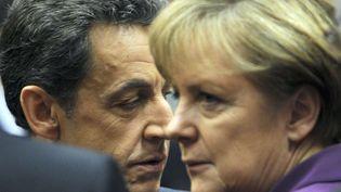 Le président de la République Nicolas Sarkozy et la chancelière allemande Angela Merkel au sommet européen de Bruxelles (Belgique), le 9 décembre 2011. (GEERT VANDEN WIJNGAERT / AP / SIPA)
