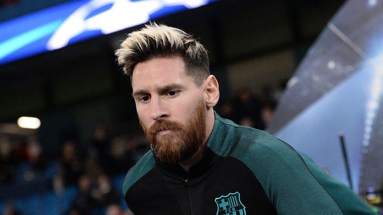 Le joueur du FC Barcelone, Lionel Messi (OLI SCARFF / AFP)