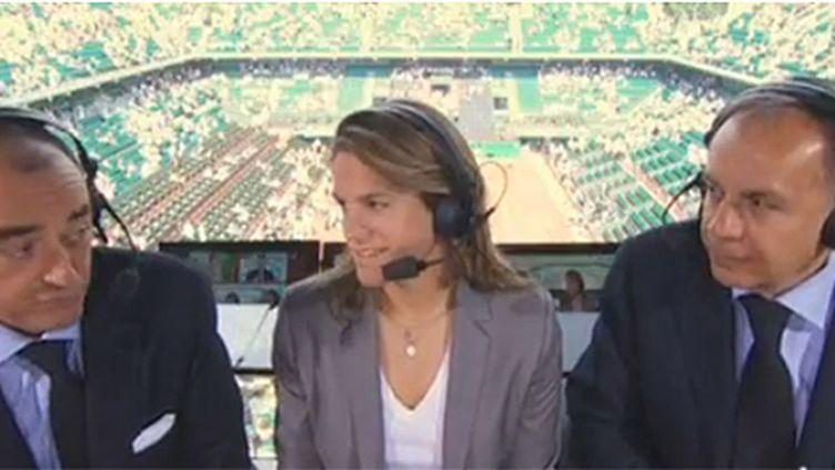 Patrice Dominguez (à droite), en compagnie d'Amélie Mauresmo et de Français Brabant à Roland-Garros