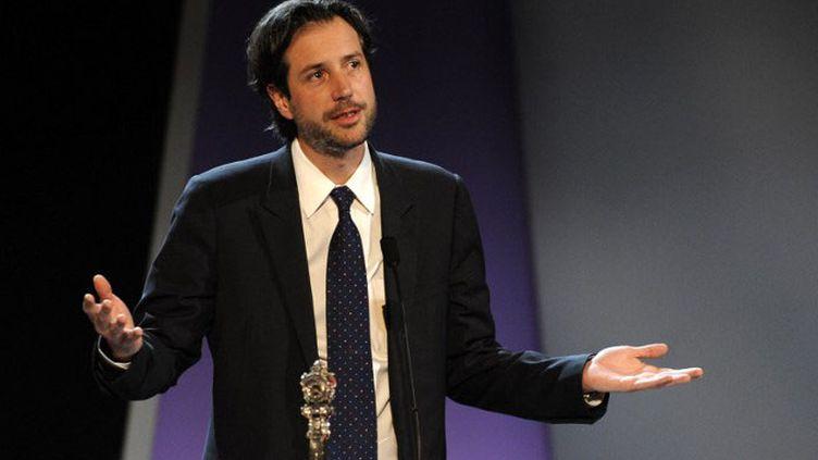 """Antonin Baudry au Festival de San Sebastian reçoit le Prix du meilleur scénario pour """"Quai d'Orsay"""" en septembre 2013  (RAFA RIVAS / AFP)"""