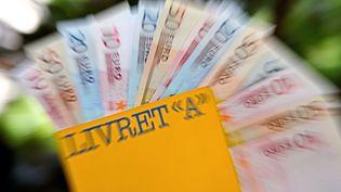 Le taux du Livret A passera de 1,25% à 1%, vendredi 1er août 2014. (PHILIPPE HUGUEN / AFP)