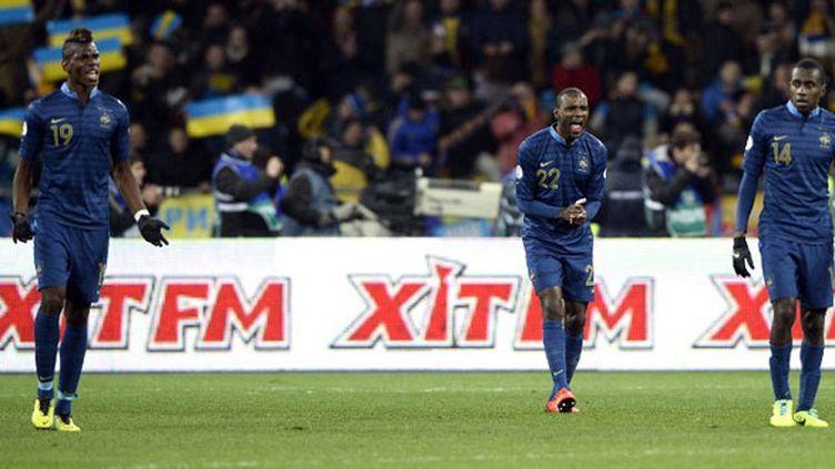 Les joueurs français Paul Pogba, Eric Abidal et Blaise Matuidi