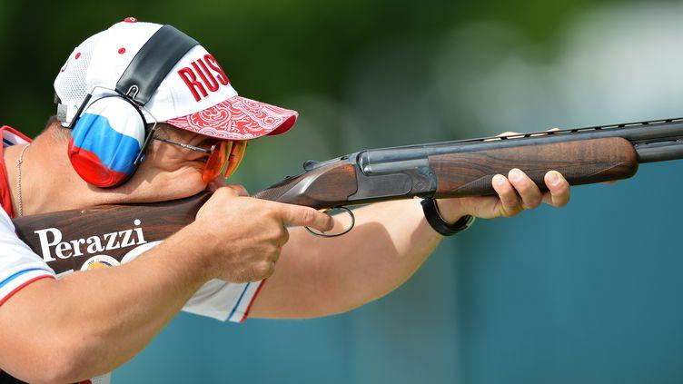 Le russe Alexei Alipov lors des épreuves de qualification de tir aux Jeux olympiques de Londres, le 5 août 2012. (VLADIMIR PESNYA / AFP)