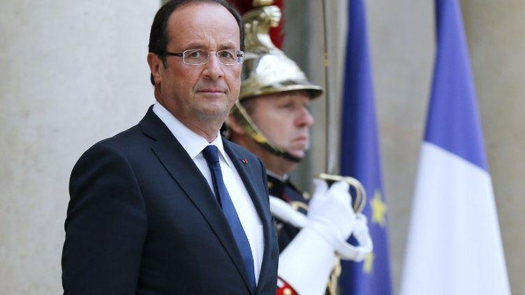 François Hollande, sur le perron de l'Elysée, le 12 septembre 2012. (FRANCOIS GUILLOT / AFP)