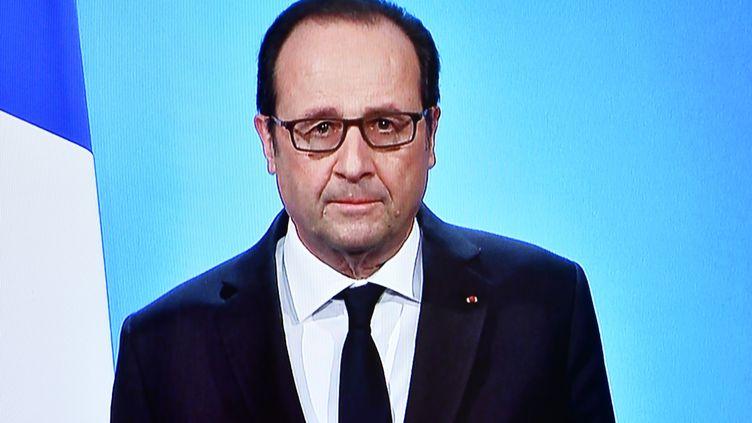 Capture de l'allocution télévisée de François Hollande, le 1er décembre à Paris (OLIVIER MORIN / AFP)
