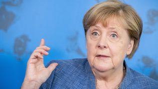 La chancelière allemande, Angela Merkel, lors d'une conférence de presse, le 13 juillet 2021, à Berlin. (MICHAEL KAPPELER / AFP)