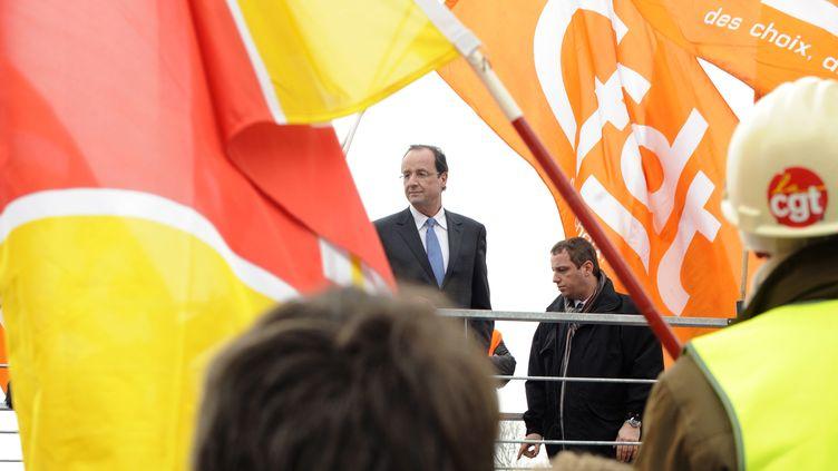 François Hollande, alors candidat à l'élection présidentielle, le 24 février 2012 à l'usine ArcelorMittal de Florange (Moselle). (JEAN-CHRISTOPHE VERHAEGEN / AFP)