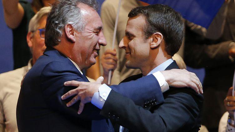 François Bayrou et Emmanuel Macron, le 12 avril 2017, à Paris. (REGIS DUVIGNAU / X00095)