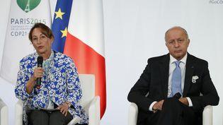 Ségolène Royal et Laurent Fabius en conférence de presse en préparation de la COP21, le 10 septembre 2015. (PATRICK KOVARIK / AFP)