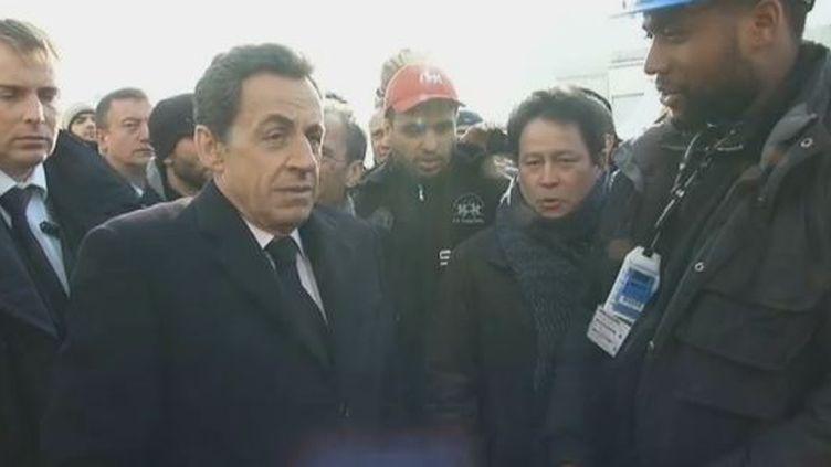 Nicolas Sarkozy avec les salariés de la centrale nucléaire de Fessenheim (Haut-Rhin), le 9 février 2012. (FTVi / FRANCE 2)