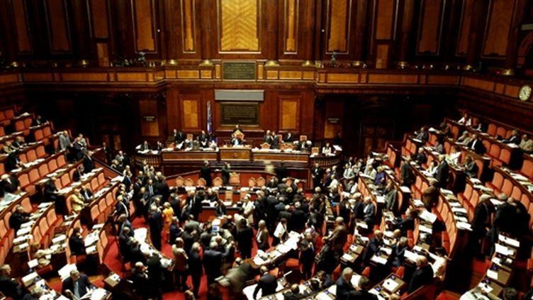 Les sénateurs italiens, le 15 juillet 2010. 170 ont voté en faveur du plan d'austérité, 136 d'entre ont voté contre. (AFP PHOTO/ FILIPPO MONTEFORTE)