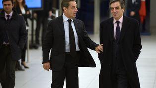 Nicolas Sarkozy (à gauche) et François Fillon au siège de l'UMP, à Paris, le 2 décembre 2014. (LIONEL BONAVENTURE / AFP)