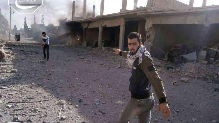 Des rebelles dans la ville deQousseir (Syrie), le 31 mai 2013. (ANONYMOUS / AP / SIPA)