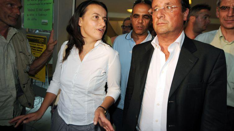 La patronne d'Europe Ecologie-Les Verts, Cécile Duflot, et le candidat PS à la présidentielle, François Hollande, le 21 août 2008 à Toulouse. (PASCAL PAVANI / AFP PHOTO)