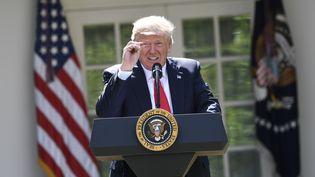 Donald Trump, président des Etats-Unis, lors de sa conférence de presse où il annonce le retrait des USA de l'accord de Paris sur le climat, le 1er juin 2017, à Washington. (SAUL LOEB / AFP)