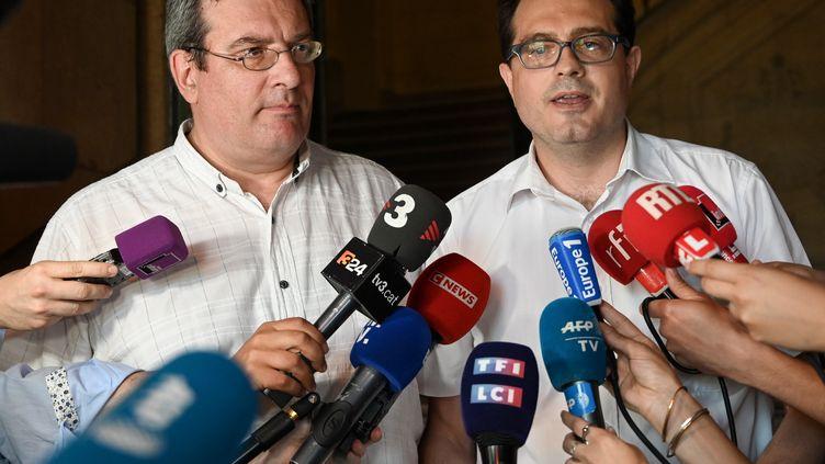 Maitres Jean Paillot et Jérôme Triomphe, les avocats des parents de Vincent Lambert. (DOMINIQUE FAGET / AFP)