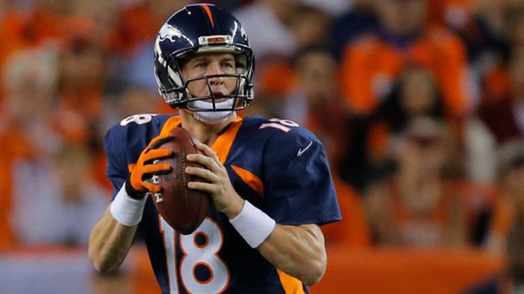 Peyton Manning (Denver Broncos) est le nouveau recordman des TD lancés en une saison (510) (DOUG PENSINGER / GETTY IMAGES NORTH AMERICA)