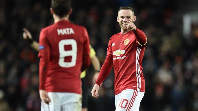 Wayne Rooney a encore marqué ce soir. (OLI SCARFF / AFP)