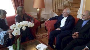 Federica Mogherini, chef de la diplomatie européenne, rencontre Javad Zarif, ministre iranien des Affaires étrangères, samedi 16 janvier 2016. (YVES HERMAN / REUTERS)