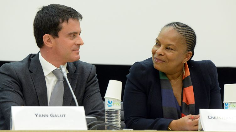 Le Premier ministre Manuel Valls et la garde des Sceaux Christiane Taubira, le 12 novembre 2013 à Paris. (PIERRE ANDRIEU / AFP)