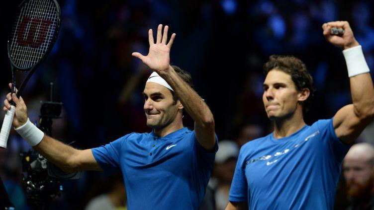Roger Federer et Rafael Nadal se sont imposés en simple et en double ce samedi (MICHAL CIZEK / AFP)