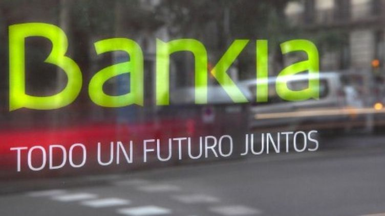 «Pour un futur commun» : la banque espagnole Bankia, partiellement nationalisée, annonce la couleur dans un pays miné par un système bancaire défaillant. (AFP PHOTO/MANUEL COHEN)