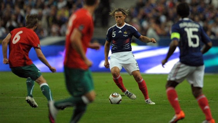 Philippe Mexes à la relance avec les Bleus (BERTRAND LANGLOIS / AFP)