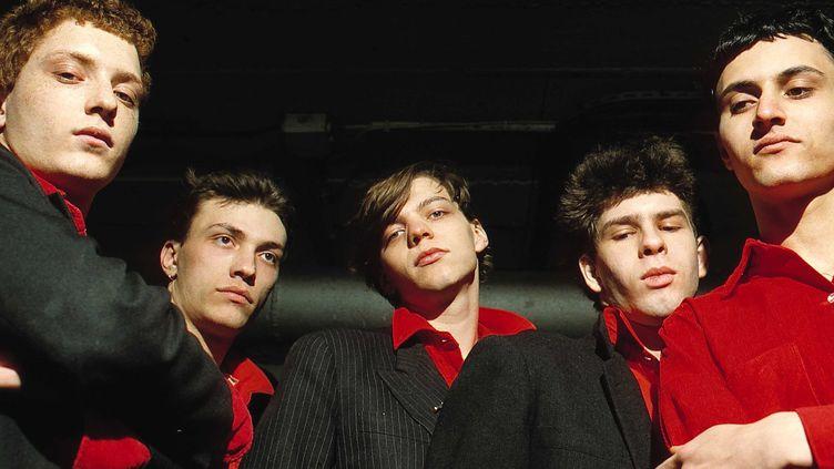 Laurent Sinclair, au centre, à côté de Daniel Darc. Taxi Girl en mars 1980 avec de g à d : Piere Woldsohn (batterie), Daniel Darc (chant), Laurent Sinclair (synthés), Stegane Erard (basse) et Mirwais (guitare). (FAUX/SIPA)