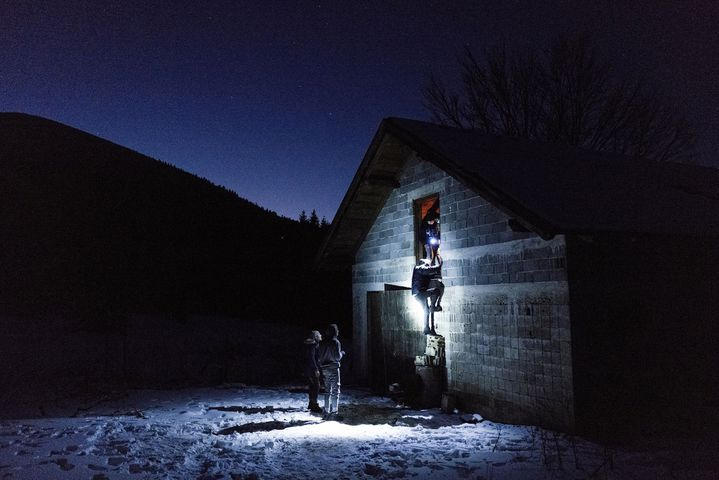 Afghans spending night in the mountains in abandoned stable before attempting to cross to Croatia. (NIKLAS MELTIO)