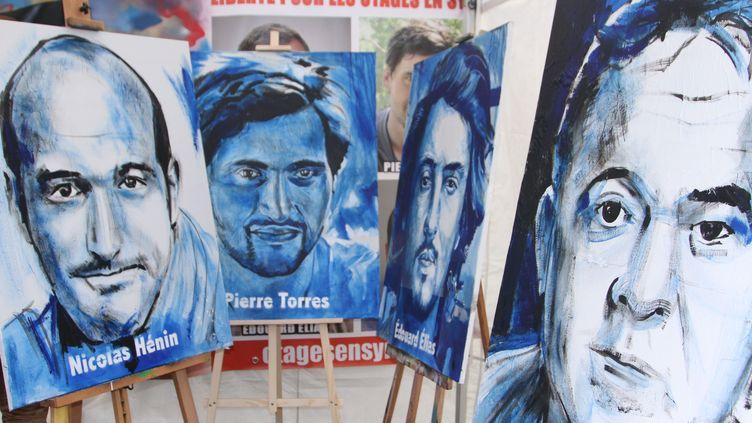 Rassamblement pour les journalistes, Didier Francois, Edouard Elias, Nicolas Henin et Pierre Torres detenus en Syrie. Paris, le 09 novembre 2013. (SEVGI / SIPA)