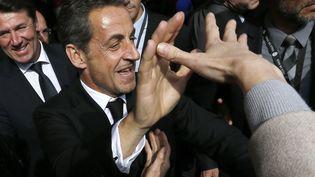 L'ancien président de la République Nicolas Sarkozy lors de son arrivée à l'Institut Claude-Pompidou, le 10 mars 2014 à Nice (Alpes-Maritimes). (VALERY HACHE / AFP)