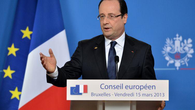 François Hollande lors de la conférence de presse donnée en marge du sommet européen de Bruxelles (Belgique), le 15 mars 2013. (BERTRAND LANGLOIS / AFP)