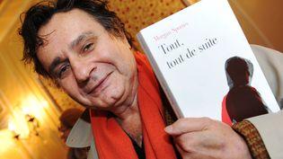 """Morgan Sportès présente son roman """"Tout, tout de suite"""" (Fayard), le 16 novembre 2011. (MEHDI FEDOUACH / AFP)"""