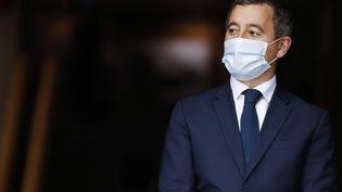 Le ministre de l'Intérieur, Gérald Darmanin, lors d'une visite d'Emmanuel Macron à la préfecture de Seine-Saint-Denis, à Bobigny, le 20 octobre 2020. (LUDOVIC MARIN / POOL / AFP)